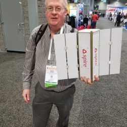 Space IT Bridge Editor Doug Mohney holding Spire 3U cubesat